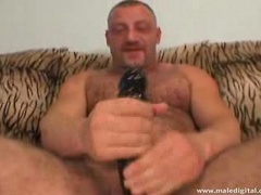 Hot DILF toying his ass with a couple of different big toys. Posted by: Male Digital